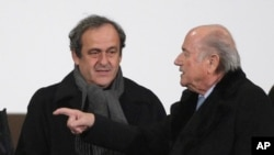 FILE - UEFA president Michel Platini, left, and FIFA president Sepp Blatter on Dec. 16, 2014.