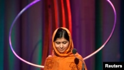 "FILE - Malala Yousafzai gives a speech after receiving the ""Leadership in Civil Society"" award at the Clinton Global Initiative 2013 in New York September 25, 2013."