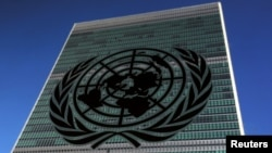 FILE - The United Nations logo is pictured in front of the United Nations Headquarters building during the 71st United Nations General Assembly in the Manhattan borough of New York, U.S.