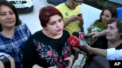 FILE - Khadija Ismayilova, then a reporter for Radio Free Europe/Radio Liberty, speaks to journalists after her release from prison in Baku, Azerbaijan, May 25, 2016.