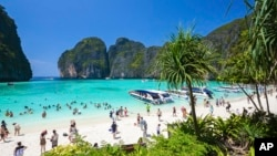 In this March 4, 2017, photo, tourists enjoy the popular Maya bay on Phi Phi island, Krabi province. (AP Photo/Rajavi Omanee)