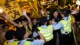 Pro-democracy activists clash with the police during a protest outside the hotel where China's National People's Congress (NPC) Standing Committee Deputy General Secretary Li Fei is staying, in Hong Kong, September 1, 2014.