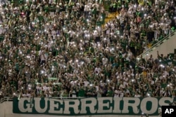 Supporters of Brazil's Chapecoense soccer team gather for a memorial to remember the players who died in a plane crash in Colombia, at Arena Condado stadium in Chapeco, Brazil, Nov. 30, 2016.