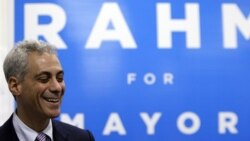 Rahm Emanuel smiles as he talks to his supporters and volunteers at his campaign office in Chicago
