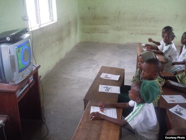 "Students watch ""Sesame Square"" in Ijebu-Lekki, Nigeria, in February 2012. Creators of ""Sesame Square"" feared being targeted by Boko Haram. (N. Moland)"