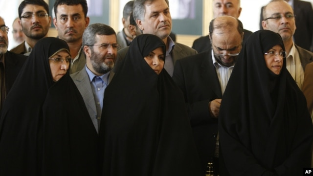 Marzieh Vahid Dastgerdi, center, is seen during a press conference when she was nominated as health minister by Iranian President Mahmoud Ahmadinejad in 2009.