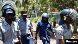 Police on Saturday assaulted Doug Coltart, a member of the Zimbabwe Lawyers for Human Rights, while he was on duty at a local police station.