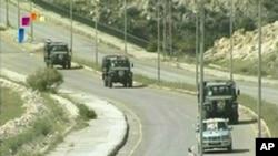 叙利亚军车驶离南部城镇德拉