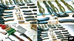 The Syrian official news agency SANA shows weapons that were found in the province of Homs, Syria, September 27, 2011.