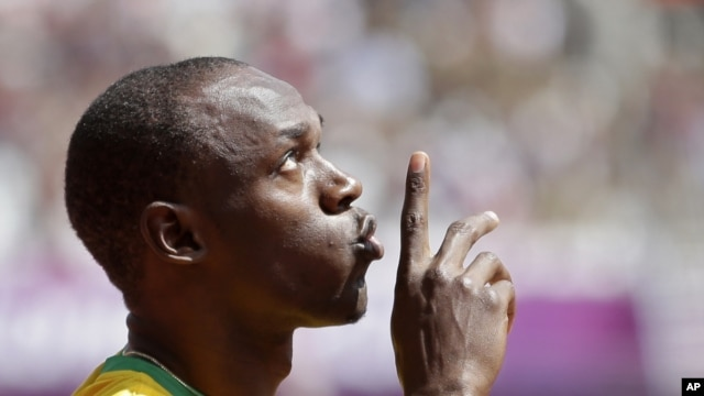 Jamaica's Usain Bolt gestures before competing in a men's 100-meter heat in London, August 4, 2012.