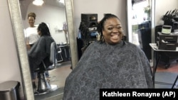 Elicia Drayton (right) laughs with salon owner Stephanie Hunter-Ray at Exquisite U hair salon in Sacramento, Calif., Wednesday, July 3, 2019.
