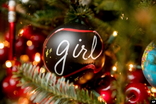"The Library of the White House is decorated during a preview of the 2016 holiday decor, Tuesday, Nov. 29, 2016, in Washington. Ornaments on display spell out the word ""girls"" in 12 different languages. (AP Photo/Andrew Harnik)"