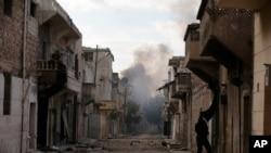 Asap di kawasan timur Aleppo, Suriah, 3 Desember 2016.