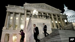 Congressmen walk down the steps of the House of Representatives as they work throughout the night on a spending bill, on Capitol Hill in Washington (File Photo)