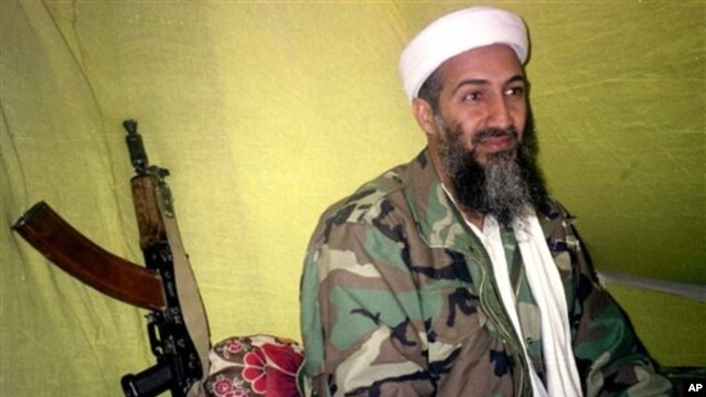 In this Dec. 24, 1998 file photo, al Qaida leader Osama bin Laden speaks to a selected group of reporters in mountains of Helmand province in southern Afghanistan