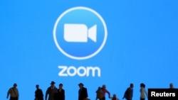 Une illustration avec le logo de Zoom en arrière-plan. (Reuters)