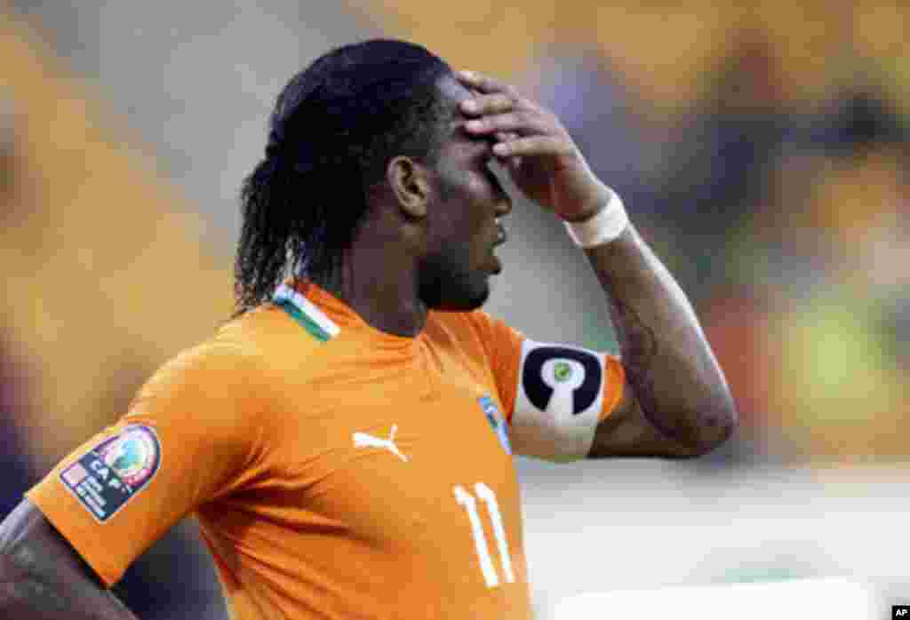 "Ivory Coast's Didier Drogba reacts after missing a goal scoring opportunity during their African Nations Cup soccer match against Sudan at Estadio de Malabo ""Malabo Stadium"", in Malabo January 22, 2012."