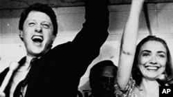 FILE - Former Arkansas Gov. Bill Clinton and his wife Hillary celebrate his victory in the Democratic runoff in Little Rock, Ark., June 8, 1982.