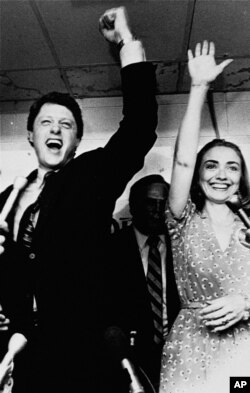 FILE - Former Arkansas Gov. Bill Clinton and his wife, Hillary, celebrate his victory in the Democratic runoff in Little Rock, Arkansas, June 8, 1982.