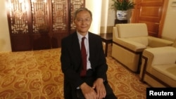 Zhong Jianhua, China's special Envoy to Africa, poses for a photograph during an interview with Reuters at the Ministry of Foreign Affairs in Beijing, July 16, 2012.