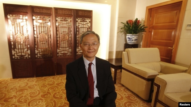 FILE - Zhong Jianhua, China's special Envoy to Africa, poses for a photograph during an interview with Reuters at the Ministry of Foreign Affairs in Beijing.