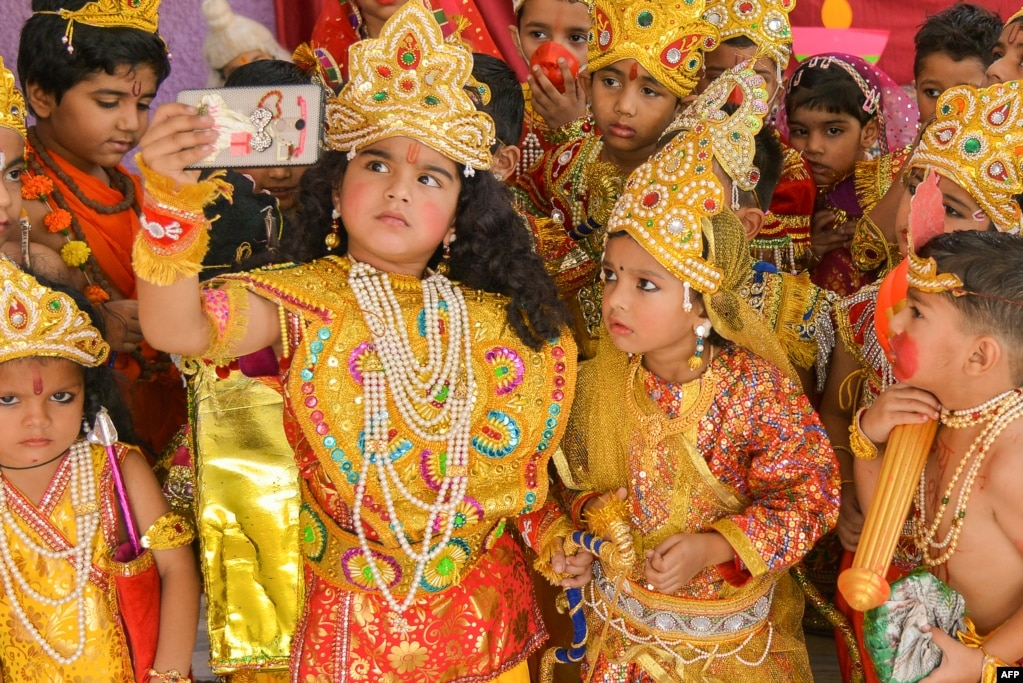 Children dressed as the Hindu deities Rama and Sita take a selfie at an event to celebrate the Diwali festival in Ajmer, Rajasthan state, India.