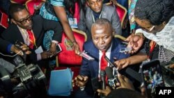 "FILE - Vital Kamerhe, President of the opposition Citizen Front (Front Citoyen, UNC) party (C) speaks to the media during the opening of a Congolese ""National Dialogue"" in the Democratic Republic of Congo's capital Kinshasa, Sept. 1, 2016."