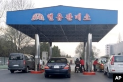 FILE - Cars line up at at a gas station in Pyongyang, North Korea, April 1, 2016. North Korea has been condemned and sanctioned for its nuclear ambitions, yet has still received food, fuel and other aid from its neighbors and adversaries for decades.
