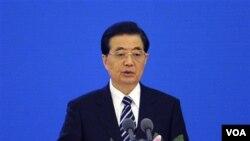 """Presiden Tiongkok Hu Jintao diberitakan akan berada di Addis Ababa tanggal 28 Januari untuk membuka apa yang disebut """"hadiah Tiongkok untuk Afrika,"""" yaitu markas besar Uni Afrika yang didanai Tiongkok dan sebagian besar dibangun oleh buruh Tiongkok."""