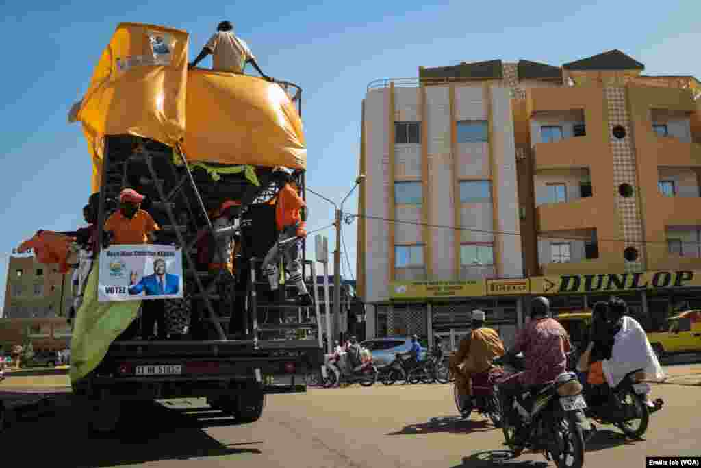Supporters of presidential candidate Roch Marc Christian Kaboré parade in Burkina Faso's capital, Ouagadougou.