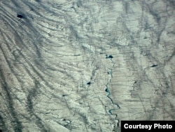 The surface of the Greenland Ice Sheet. A new study uses NASA data to provide the first detailed reconstruction of how the ice sheet and its many glaciers are changing. The research was led by University at Buffalo geologist Beata Csatho.