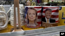 Coffee mugs for sale with the images of Democratic presidential candidate Hillary Clinton and Republican presidential candidate Donald Trump sit side by side on a shelf of a souvenir stand at the corner of Constitution Avenue NW and 17th Street NW in Washington, Tuesday, Feb. 16, 2016. (AP Photo/Carolyn Kaster)