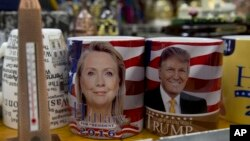 Coffee mugs for sale with the images of Democratic presidential candidate Hillary Clinton and Republican presidential candidate Donald Trump sit side by side on a shelf of a souvenir stand in Washington, D.C., Feb. 16, 2016. (AP Photo/Carolyn Kaster)