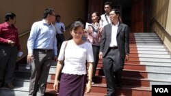 FILE - Opposition lawmaker Mu Sochua and her colleagues walk out of the Phnom Penh court room after a judge bans them from attending the hearing.