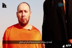 FILE - An image grab taken from a video released by the Islamic State (IS) and identified by private terrorism monitor SITE Intelligence Group purportedly shows U.S. freelance writer Steven Sotloff dressed in orange and on his knees.