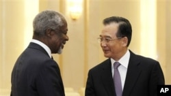 Former U.N. Secretary General Kofi Annan, left, is greeted by Chinese Premier Wen Jiabao during their meeting at the Great Hall of People in Beijing, March 27, 2012.