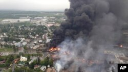 Smoke billows from fire at the site of a train derailment in Lac Megantic, Quebec, July 6, 2013.