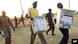 Men carry ballot boxes after elections in South Sudan in 2011.