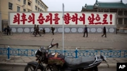 "FILE - A propaganda billboard, which reads ""Forward to the Ultimate Victory"" in Korean is seen standing in central Kaesong, North Korea."