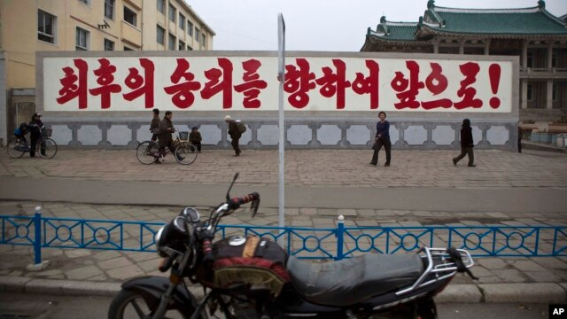 """FILE - A propaganda billboard, which reads """"Forward to the Ultimate Victory"""" in Korean is seen on display in central Kaesong, North Korea."""