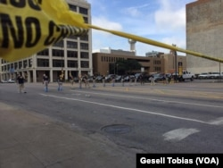 Law enforcement personnel investigate a mass shooting scene after an attack that killed and wounded Dallas police officers, in Dallas, Texas, July 8, 2016.