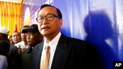 Cambodia National Rescue Party (CNRP) President Sam Rainsy looks on after a press conference in his main party headquarters.