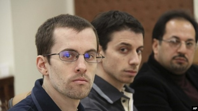 American hikers Shane Bauer (L) and Josh Fattal and their translator attend the first session of their trial in Tehran  (file photo)