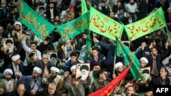 Iranians chant slogans as they march in support of the government near the Imam Khomeini grand mosque in the capital Tehran, Dec. 30, 2017.