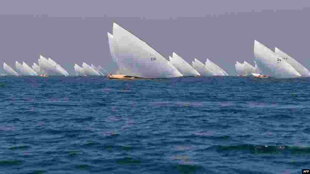 "Competitors sail their boats in the annual long-distance ""60ft Dubai Traditional Dhow Sailing Race"" in the United Arab Emirates, March 7, 2020."