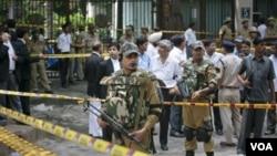 Polisi khusus anti teror India mengamankan lokasi pemboman di New Delhi (7/9). Penyelidik belum menemukan bukti konklusif mengenai pemboman tersebut.
