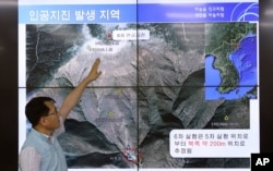 Earthquake and Volcano of the Korea Monitoring Division Director Ryoo Yong-gyu explains an artificial earthquake in North Korea, in Seoul, South Korea, Sept. 3, 2017.