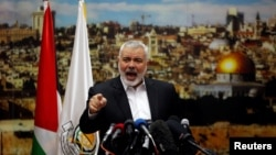 FILE - Hamas Chief Ismail Haniyeh gestures as he delivers a speech in response to U.S. President Donald Trump's decision to recognize Jerusalem as the capital of Israel, in Gaza City, Dec. 7, 2017.