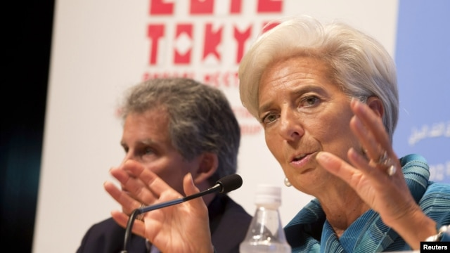 International Monetary Fund (IMF) Managing Director Christine Lagarde (R) and IMF First Deputy Managing Director David Lipton hold a news conference at the annual meetings of the International Monetary Fund and the World Bank Group in Tokyo October 11, 20