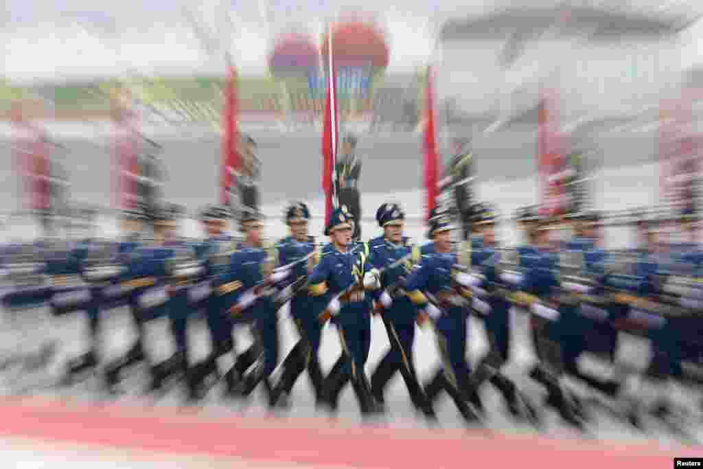 Members of the honor guard march during an official welcoming ceremony for Israel's Prime Minister Benjamin Netanyahu at the Great Hall of the People in Beijing, China.